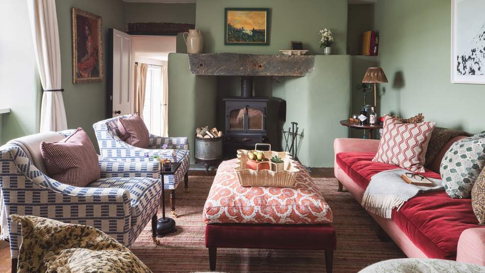 The stunning sitting room with cosy wood burner is just a delight to retire to at the end of a day out exploring
