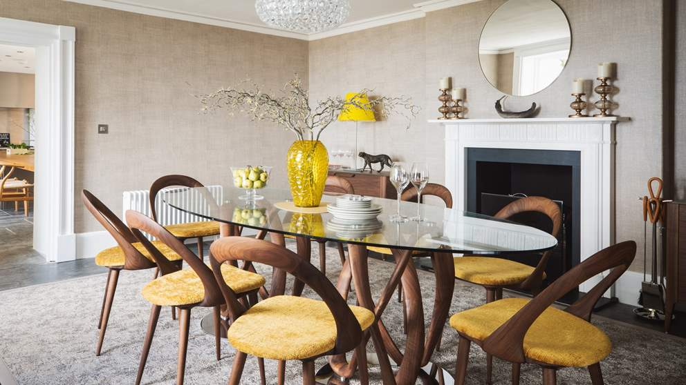 The formal dining room with open fireplace, the perfect setting for celebrations and gatherings