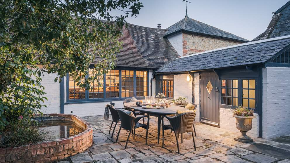 The gorgeous outdoor dining space is just perfect for evening meals on balmy nights