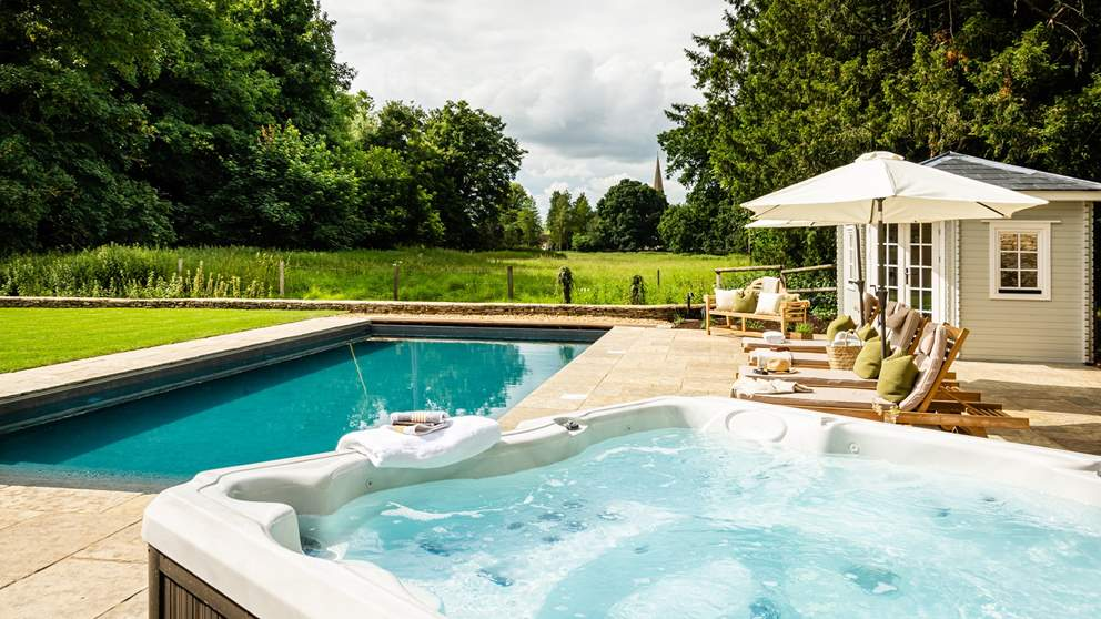 Both a heated pool and a bubbling hot tub awaits...