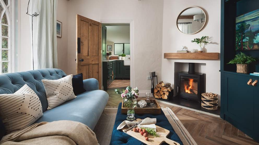 The stunning sitting room, the perfect spot to curl up together and watch the cosy wood burner