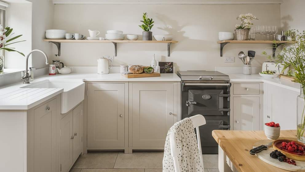 The lovely country kitchen is the perfect setting for whipping up delicious meals