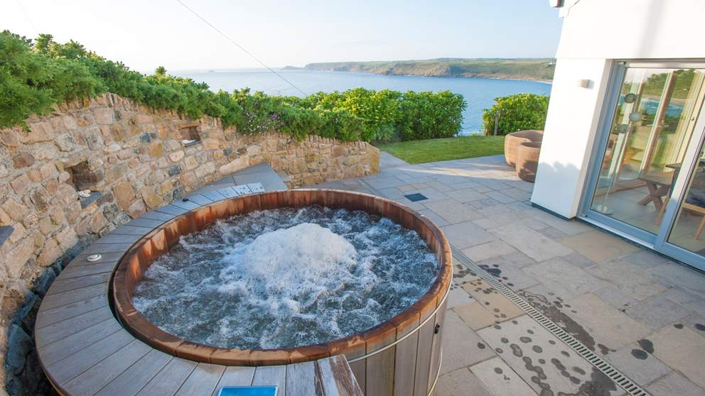 A magnificent hot tub to sink into after a day revelling in the rolling surf on the beach below.