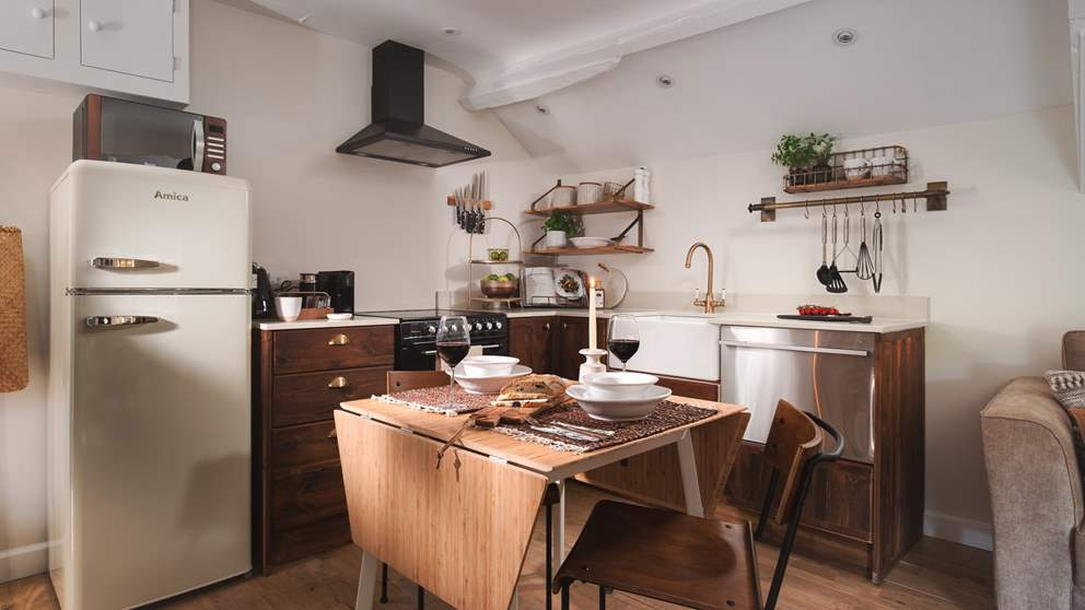 Uncover the gorgeously rustic, bespoke kitchen, just perfect for dining in cosy cottage style...