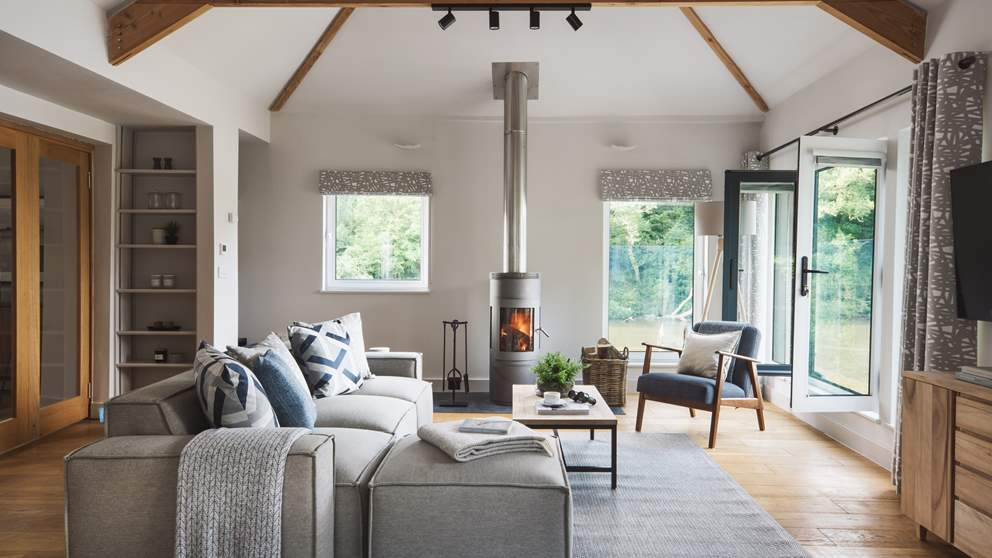 Adorned with oak beams and underfloor heated oak flooring, you'll find endless comfort and luxury in this gorgeous living space...
