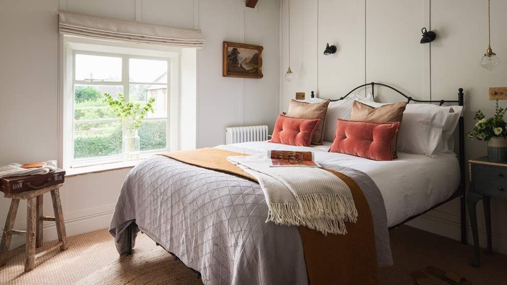One of the beautiful bedrooms, we just love the wood panelled walls and wrought iron bed