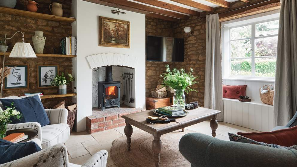 The sumptuous sitting room, a dreamy delight with wood burning stove