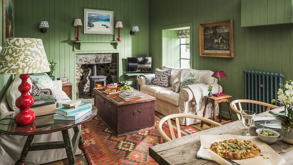 The oh-so-cosy living space with flickering wood burner is the perfect spot to tuck yourself away...