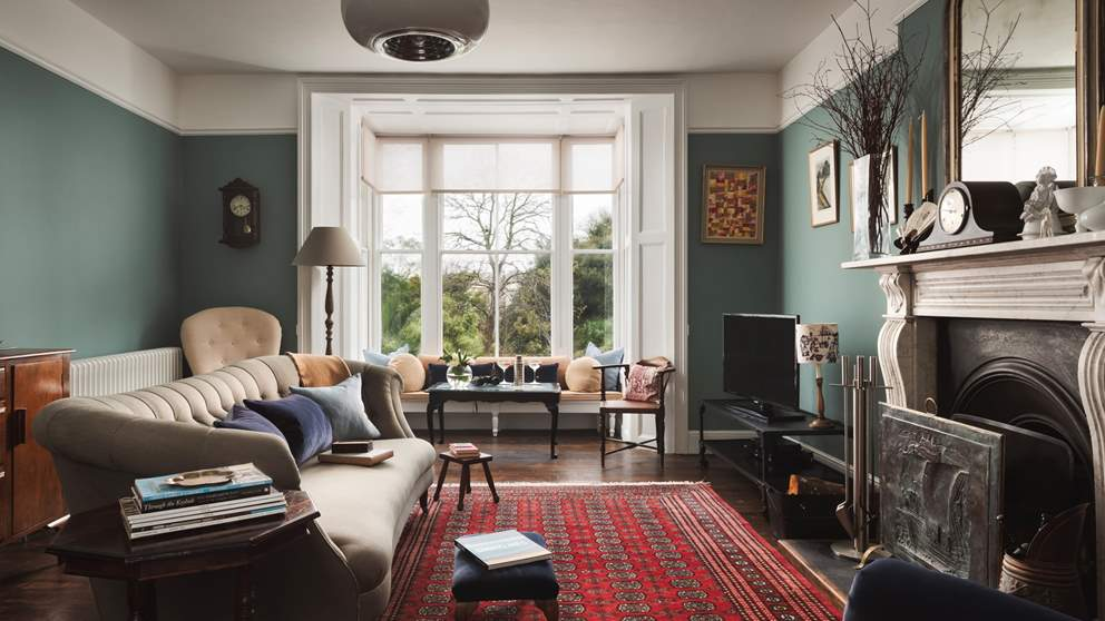 Set on the first floor and running the length of the house, this lovely room has a gorgeous bay window with a window seat that overlooks Morrab Gardens.
