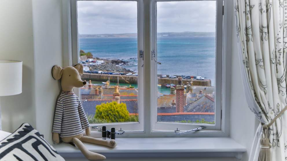 This pretty and unique retreat boasts a bird's eye view of Mousehole and beyond.