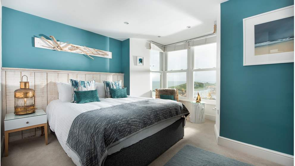 Wake up to the sound of the Cornish waves in this alluring bedroom.