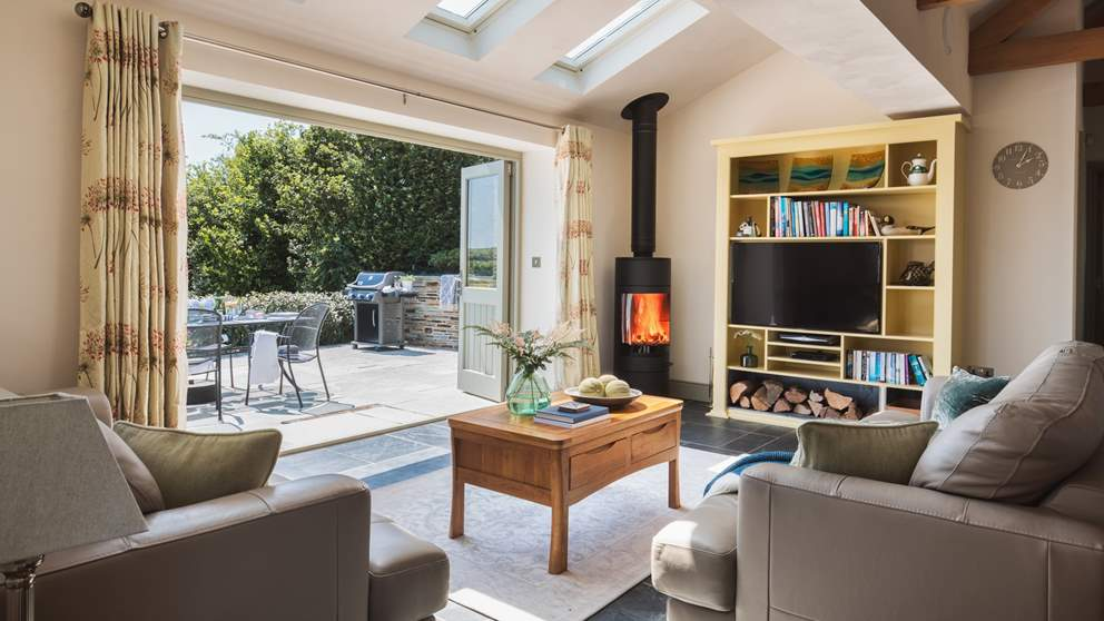 The bi-fold doors bring the outside in on warmer days - and there's a wood-burner for chillier days, perfect!
